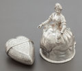 Silver Smalls, A SILVER FIGURAL BELL AND HEART-SHAPED BOX. 18th/19th centuries.Marks to bell: 800, B, (partially effaced marks). 3-1/8...