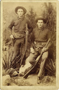 "Photography:Cabinet Photos, TWO YOUNG COWBOYS ""GUNS, BOWIE KNIVES, RIFLES"" ca. 1880 These twoCowboys have all the accouterments for the Wild West and t...(Total: 1 Item)"