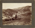 Photography:Cabinet Photos, L.S. HAZELTINE IMPERIAL CABINET OF AN UNKNOWN MONTANA TOWN, 1900.Dramatic bird's-eye view of a thriving mountain town some...(Total: 1 Item)