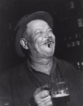 Photographs:20th Century, WEEGEE (American, 1899-1968). Saturday Night Drunk, circa1940. Gelatin silver, printed later. 13-1/4 x 10-1/2 inches (3...
