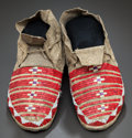 American Indian Art:Beadwork and Quillwork, A PAIR OF SIOUX QUILLED AND BEADED HIDE MOCCASINS. c. 1890...