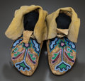 American Indian Art:Beadwork and Quillwork, A PAIR OF NEZ PERCE BEADED HIDE MOCCASINS. c. 1890...