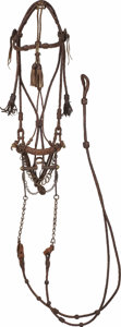 "Western Expansion:Cowboy, ""PRISON MADE"" BRAIDED HEADSTALL & REINS ca. MID 1900's -Loosely braided leather with tassels on brown band and cheeks.Exe..."