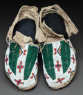 American Indian Art:Beadwork and Quillwork, A PAIR OF SIOUX BEADED HIDE MOCCASINS. c. 1885...