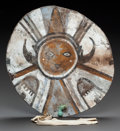 American Indian Art:Pipes, Tools, and Weapons, A PUEBLO PAINTED HIDE DANCE SHIELD. c. 1880 ...