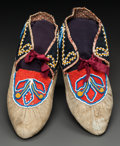 American Indian Art:Beadwork and Quillwork, A PAIR OF TAHLTAN BEADED HIDE MOCCASINS . c. 1875...