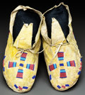 American Indian Art:Beadwork and Quillwork, A PAIR OF CHEYENNE/ARAPAHO BEADED HIDE MOCCASINS. c. 1890...