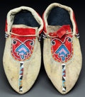 American Indian Art:Beadwork and Quillwork, A PAIR OF OJIBWE BEADED HIDE MOCCASINS. c. 1890...