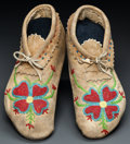 American Indian Art:Beadwork and Quillwork, A PAIR OF PLATEAU BEADED HIDE MOCCASINS. c. 1900...