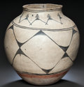 American Indian Art:Pottery, A LARGE SANTO DOMINGO OR COCHITI POLYCHROME STORAGE JAR. c. 1875...