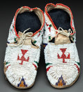 American Indian Art:Beadwork and Quillwork, A PAIR OF CHEYENNE CHILD'S BEADED HIDE MOCCASINS...