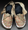 American Indian Art:Beadwork and Quillwork, A PAIR OF SIOUX QUILLED AND BEADED HIDE MOCCASINS. c. 1900...