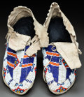 American Indian Art:Beadwork and Quillwork, A PAIR OF SIOUX BEADED HIDE MOCCASINS. c. 1915...