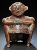 Pre-Columbian:Ceramics, AN UNUSUAL COLIMA SEATED FIGURE . c. 200 BC - 200 AD...
