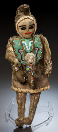 American Indian Art:Beadwork and Quillwork, AN ESKIMO BEADED HIDE FEMALE DOLL. c. 1900...