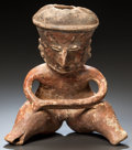 Pre-Columbian:Ceramics, A NAYARIT CHINESCO SEATED FIGURE WITH ARMS ON KNEES. c. 200 BC - 200 AD...