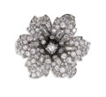Estate Jewelry:Brooches - Pins, Diamond, Platinum Clip-Brooch. The brooch, designed as a flower,centers one round brilliant-cut diamond weighing approxim...