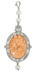 Estate Jewelry:Pendants and Lockets, Coral Cameo, Diamond, Cultured Pearl, Platinum Pendant. The pendantfeatures a high relief carved coral cameo, depicting a...