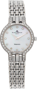 Estate Jewelry:Watches, Baume & Mercier Lady's Diamond, Mother-of-Pearl, White GoldWristwatch, retailed by Tiffany & Co.. ...