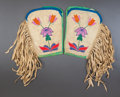 American Indian Art:Beadwork and Quillwork, A PAIR OF PLATEAU BEADED HIDE CUFFS. c. 1920...