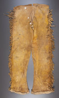 American Indian Art:Beadwork and Quillwork, A PAIR OF SOUTHERN PLAINS BOY'S FRINGED HIDE TROUSERS. c. 1890...