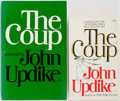 Books:Fiction, John Updike. SIGNED. The Coup. One Trade and One Mass Market Paperback. Various publishers, [1978]. Both signe... (Total: 2 Items)