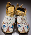 American Indian Art:Beadwork and Quillwork, A PAIR OF CHEYENNE PICTORIAL BEADED HIDE MOCCASINS. c. 1890...