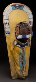 American Indian Art:Beadwork and Quillwork, A UTE BEADED HIDE CRADLEBOARD. c. 1880...