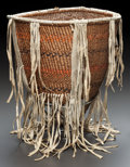 American Indian Art:Baskets, AN APACHE POLYCHROME TWINED BURDEN BASKET . c. 1915...