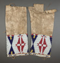 American Indian Art:Beadwork and Quillwork, A PAIR OF SIOUX GIRL'S BEADED HIDE LEGGINGS. c. 1890...