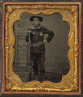 "Photography:Tintypes, WONDERFUL TINTYPE OF UNKNOWN LAWMAN - This 2.5"" x 3"" tintype depicts a confident young man in what appears to be a police un..."