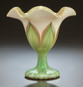 Art Glass:Other , QUEZAL IRIDESCENT GLASS FLORIFORM FOOTED VASE. Circa 1920,Engraved: QUEZAL. 5-5/8 inches high (14.3 cm). ...