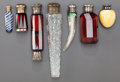 Art Glass, SEVEN VICTORIAN GLASS PERFUME VIALS. Circa 1880, Yellow marked: T(in shield), 925 S. 6-5/8 inches long (16.8 cm) (longest)...(Total: 7 Items)