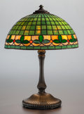 Art Glass:Other , WILKINSON LEADED GLASS AND BRONZED METAL FLEUR-DE-LIS TABLE LAMP.Circa 1930. 23 inches high x 16 inches diameter of shade (...
