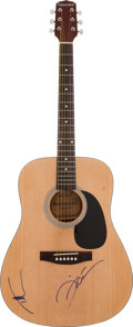 Music Memorabilia:Autographs and Signed Items, Tim McGraw and Faith Hill Signed Guitar....