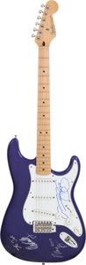 Music Memorabilia:Autographs and Signed Items, Crosby, Stills, Nash and Young Signed Purple Stratocaster....