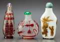 Asian, THREE CHINESE GLASS SNUFF BOTTLES. Circa 1900. 2-1/4 inches high(5.7 cm). ... (Total: 3 Items)