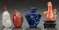 Asian, FOUR CHINESE CARVED CORAL, LAPIS, CARNELIAN, AND HARDSTONE SNUFFBOTTLES. Circa 1900. 2-1/2 inches high (6.4 cm). ... (Total: 4Items)