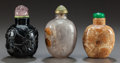 Asian, THREE CHINESE CARVED HARDSTONE SNUFF BOTTLES. Circa 1900. 3-1/4inches high (8.3 cm). ... (Total: 3 Items)