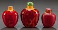 Asian, THREE CHINESE RED COMPOSITE SNUFF BOTTLES. Circa 1900. 2-3/4 incheshigh (7.0 cm). ... (Total: 3 Items)