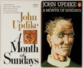 Books:Literature 1900-up, John Updike. INSCRIBED. Group of Two Editions of A Month of Sundays. Various publishers and dates. Fawcett Crest edi... (Total: 2 Items)