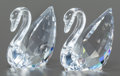 Art Glass, TWO SWAROVSKI CRYSTAL SWAN FIGURINES . Circa 2000. Marks: (swan),©. 1-3/8 inches high (3.5 cm). ...
