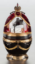 Ceramics & Porcelain, A THEO FABERGÉ RUBY GLASS, ENAMELED AND SILVER GILT MOUNTED PIANO EGG IN ORIGINAL BOX. Circa 2000. Marks: (lion ...
