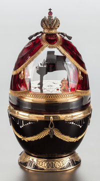 A THEO FABERGÉ RUBY GLASS, ENAMELED AND SILVER GILT MOUNTED PIANO EGG IN ORIGINAL BOX