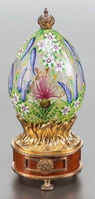 A THEO FABERGÉ ENAMELED GLASS AND GILT METAL BUDDLEIA EGG AND MUSIC BOX Circa 199