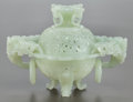 Asian:Chinese, A CHINESE PIERCED JADEITE CENSER. 20th century. 5-1/8 inches high(13.0 cm). ...