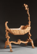 , A CONTINENTAL CARVED PINE FIGURAL CRADLE. 18th century. 67 x 43-1/2 x 25 inches (170.2 x 110.5 x 63.5 cm). ...