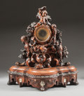 Paintings, A CONTINENTAL CARVED OAK FIGURAL CLOCK WITH PUTTI AND SHELL CARVED INLAID PORTRAITS. Circa 1875. 33 x 30-1/4 x 11 inches (83...
