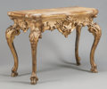 Furniture : Continental, AN ITALIAN CARVED GILT WOOD CONSOLE TABLE. 18th century. 35-1/2 x44 x 24 inches (90.2 x 111.8 x 61.0 cm). ...