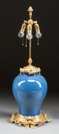 Asian:Chinese, A CHINESE BLUE PORCELAIN AND GILT BRONZE MOUNTED LAMP. 19th century. 34 inches high (86.4 cm). ...